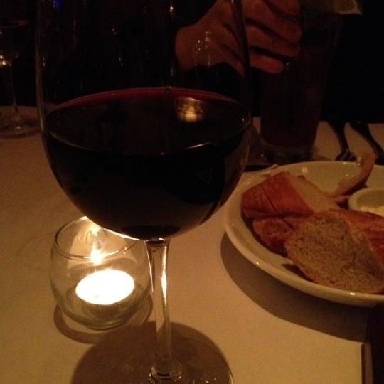 Photo taken at Village California Bistro & Wine Bar by Sean L. on 3/30/2012