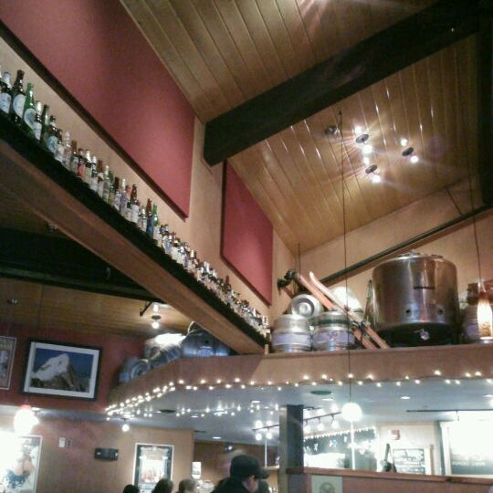 Photo taken at Moose's Tooth Pub & Pizzeria by Allie S. on 1/11/2012