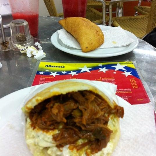 Photo taken at Panadería Los Venezolanos by Israel S. on 3/22/2011