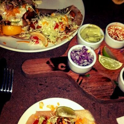 Photo taken at Fat Fish Cantina Grill by Evelyn R. on 1/5/2012