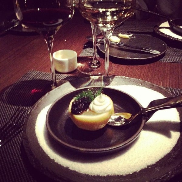 Photo taken at Jean Georges Steakhouse by Sarah K. on 3/14/2012