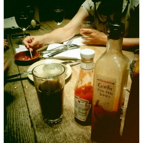Photo taken at Nando's by ian on 8/14/2012