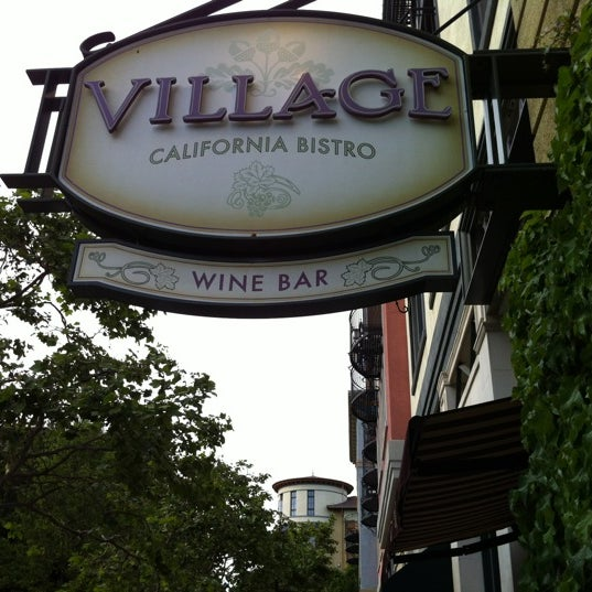 Photo taken at VILLAGE California Bistro & Wine Bar by Mike Ambassador B. on 5/2/2012