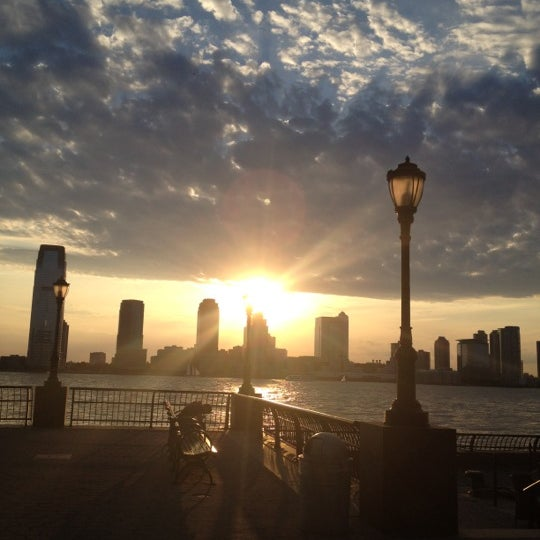 Photo taken at Battery Park City Esplanade by Caroline on 7/22/2012