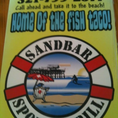 Photo taken at Sandbar Sports Grill by Jennifer G. on 7/27/2012