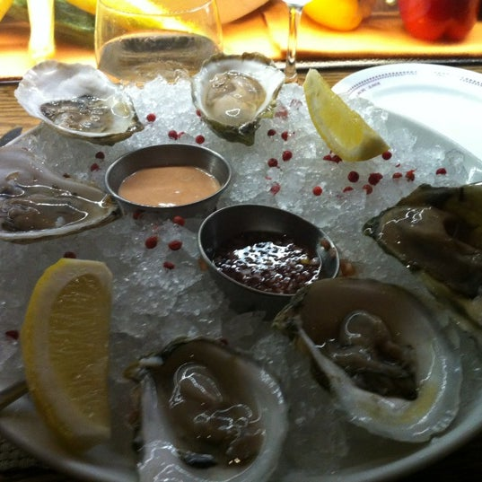 Photo taken at Bar Boulud by Anita B. on 7/25/2012