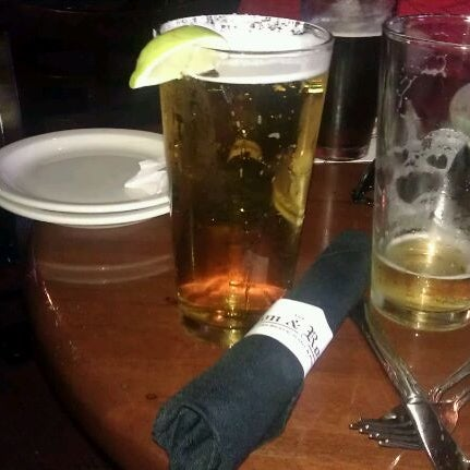Photo taken at The Lion & Rose British Restaurant & Pub by Traci M. on 3/26/2012
