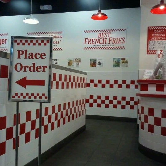 Photo taken at Five Guys by Stephanie R. on 2/25/2012
