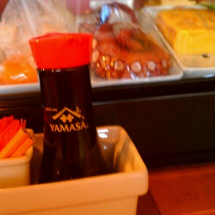 Photo taken at iSushi Cafe by Leah S. on 6/13/2012