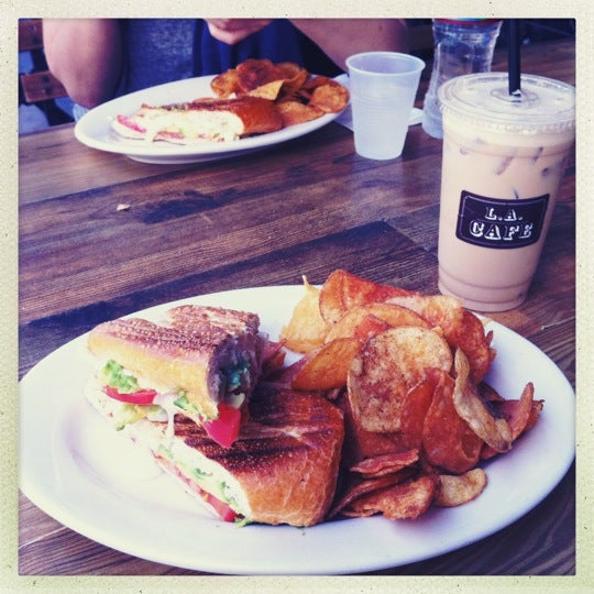 Photo taken at LA Café by Facit T. on 7/30/2012