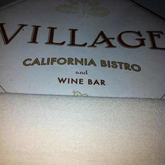 Photo taken at VILLAGE California Bistro & Wine Bar by Paris J. on 4/25/2012