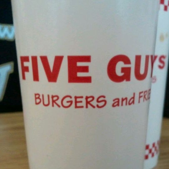 Photo taken at Five Guys by Julie D. on 2/12/2012
