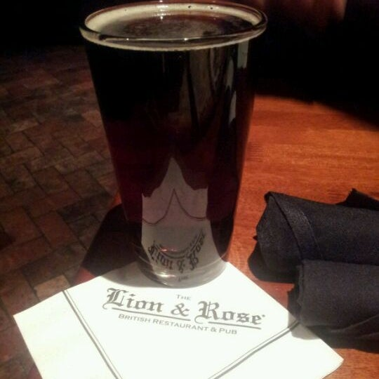 Photo taken at The Lion & Rose British Restaurant & Pub by Lupe R. on 4/21/2012