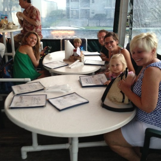 Photo taken at The Surf Restaurant & Bar by Sterling W. on 6/11/2012