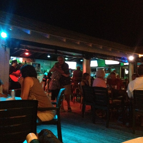 Photo taken at The Surf Restaurant & Bar by Lori P. on 5/26/2012