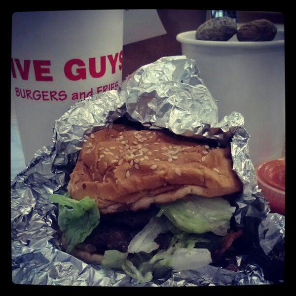Photo taken at Five Guys by Garret S. on 5/3/2012