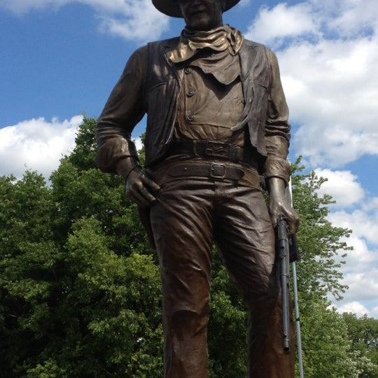 Check out the life size statue of John Wayne around the block from his house.