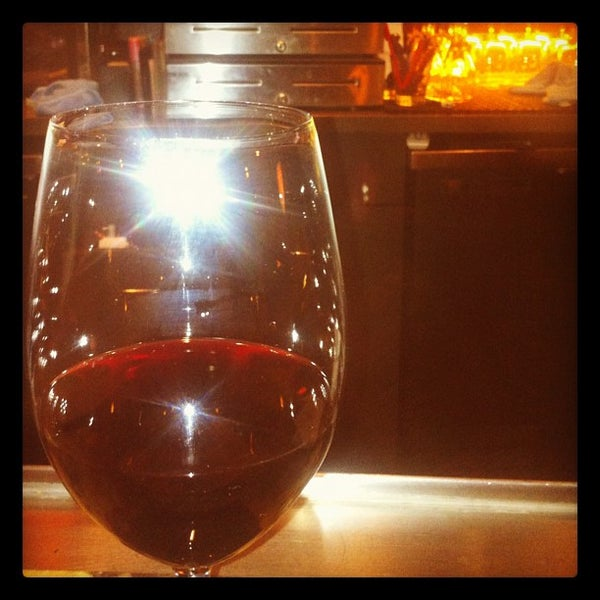 Photo taken at Lala's Wine Bar & Pizzeria by Chris G. on 7/13/2012