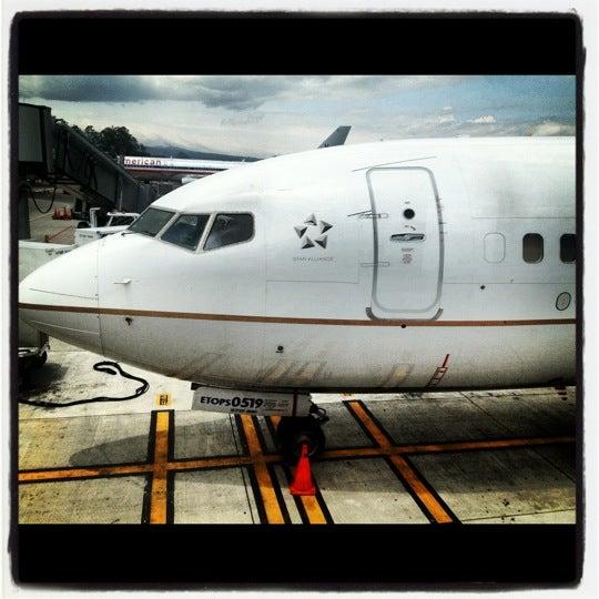 Photo taken at Gate 5 Aeropuerto Internacional Juan Santamaria by Ed V. on 5/11/2012