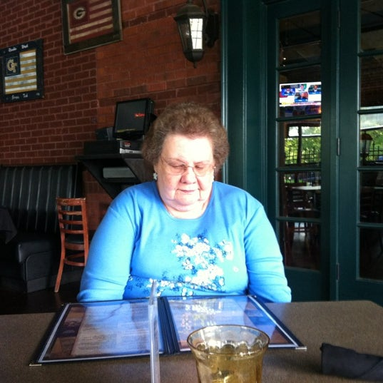 Photo taken at Green's Tavern by Cyndi S. on 5/8/2012