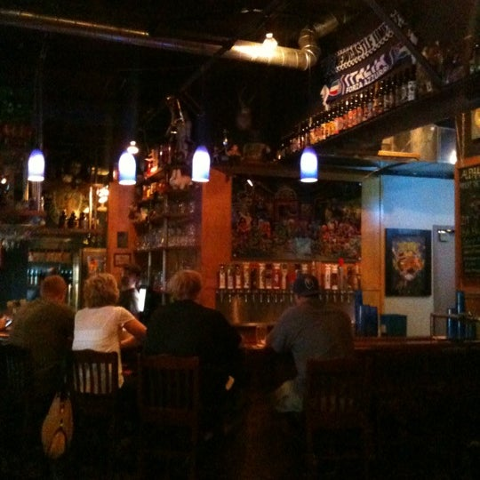 Photo taken at Three Floyds Brewery & Pub by Sally S. on 7/4/2012