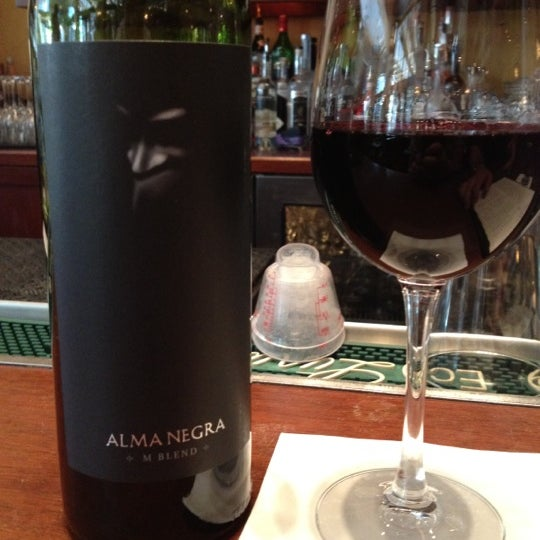 Photo taken at Village California Bistro & Wine Bar by Jaded S. on 6/28/2012
