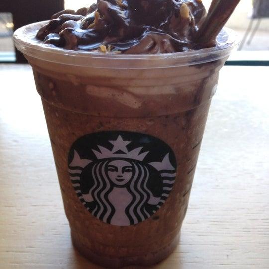 Photo taken at Starbucks by Lauren G. on 5/4/2012