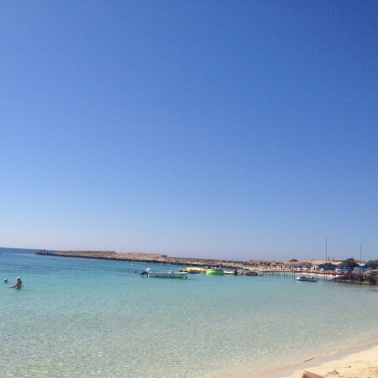 Photo taken at Makronissos beach by Alexander D. on 6/11/2012