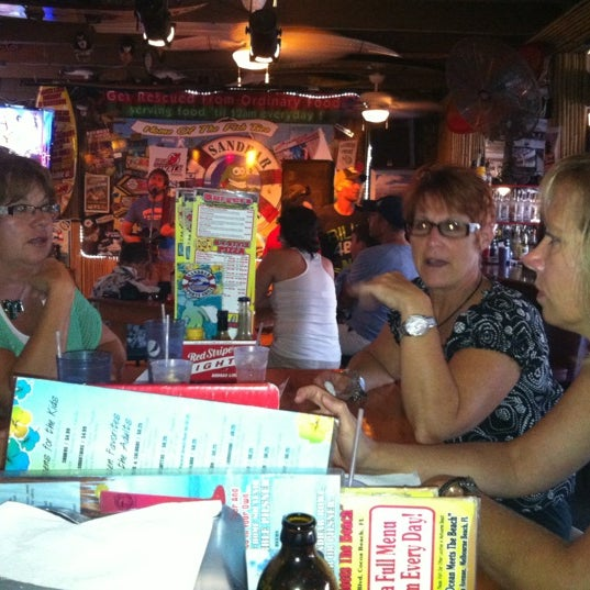 Photo taken at Sandbar Sports Grill by Mario C. on 8/3/2012