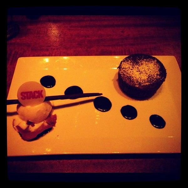 Photo taken at STACK Restaurant & Bar by Carolina W. on 4/23/2012