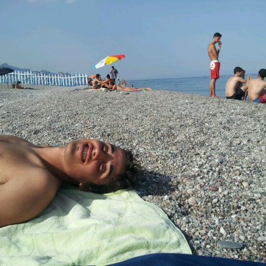 Photo taken at Spiaggia Di Fondachello by Paolo D. on 6/21/2012