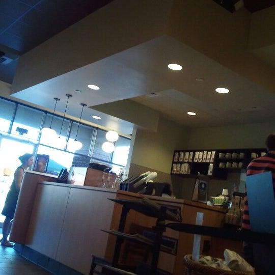 Photo taken at Starbucks by Sarah G. on 9/12/2012